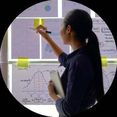business-lady-analyzing-financial-chart-9KAPTCU